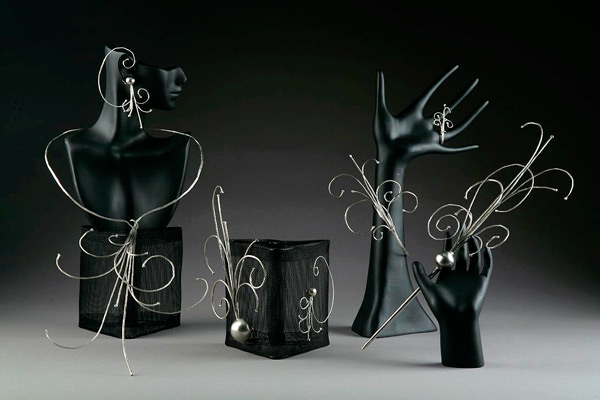 The Particle Decay Series, a set of jewelry by Kristal Feldt, won Best in Show in the 2008 Quadrennial Physics Congress Art Contest.