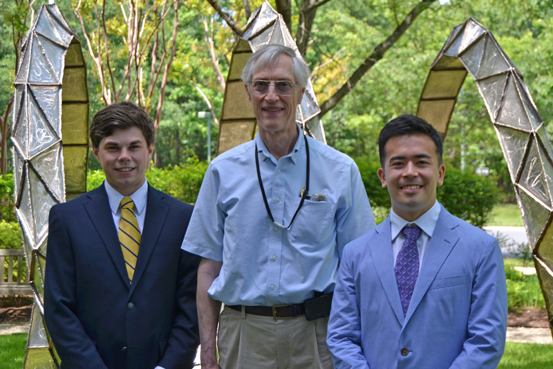 2015 SPS Mather Policy Interns Drew Roberts (l) and Elias Kim (r) with Nobel laureate John Mather (c).