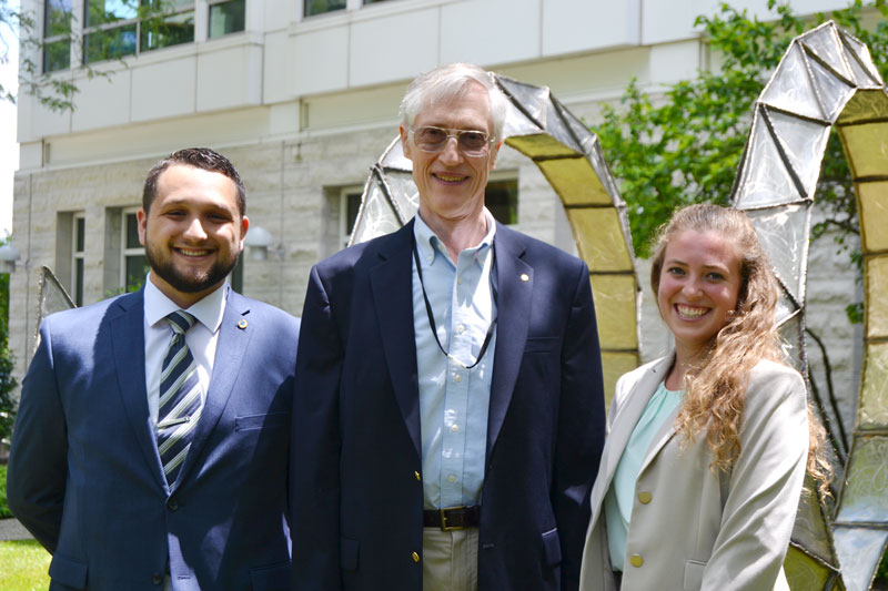 AIP Mather Policy Interns Dimitri Call and Tabitha Colter are pictured with program sponsor Dr. John Mather (center).