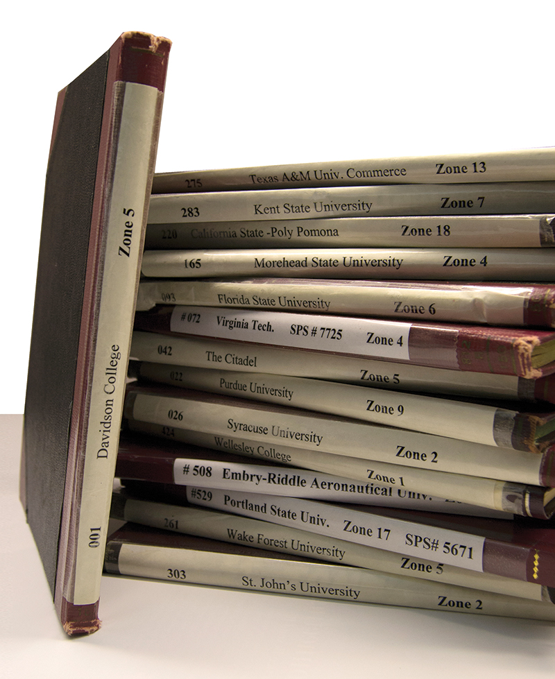 "Sigma Pi Sigma chapter ""Red Books,"" the ledgers of member names."