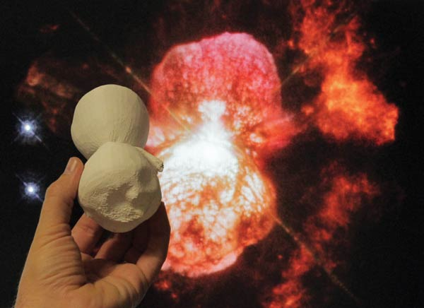 A 3-D printed model of the Homnculus Nebula is compared to a Hubble image of the object. Photo courtesy of NASA's Goddard Space Flight Center/Ed Campton