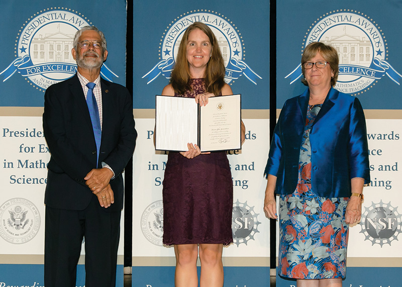 Lauren Zarandona (center) with her presidential certificate, standing between Assistant to the President for Science and Technology and White House Office of Science and Technology Policy Director John P. Holdren and Dr. Joan Ferrini-Mundy, Assistant Director, Directorate for Education and Human Resources, National Science Foundation. Credit - National Science Foundation