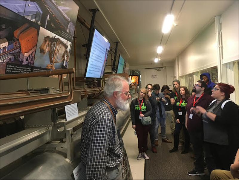 PhysCon attendees listening to a lecture on how the Klystron Gallery works to produce x-ray radiation. Photo courtesy of CSU SPS