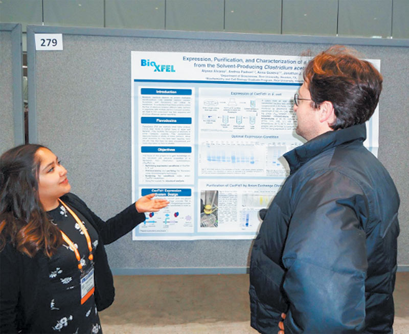 Alyssa Alvarez presenting her poster at the APS March Meeting undergraduate poster session. Photo courtesy of Alyssa Alvarez.