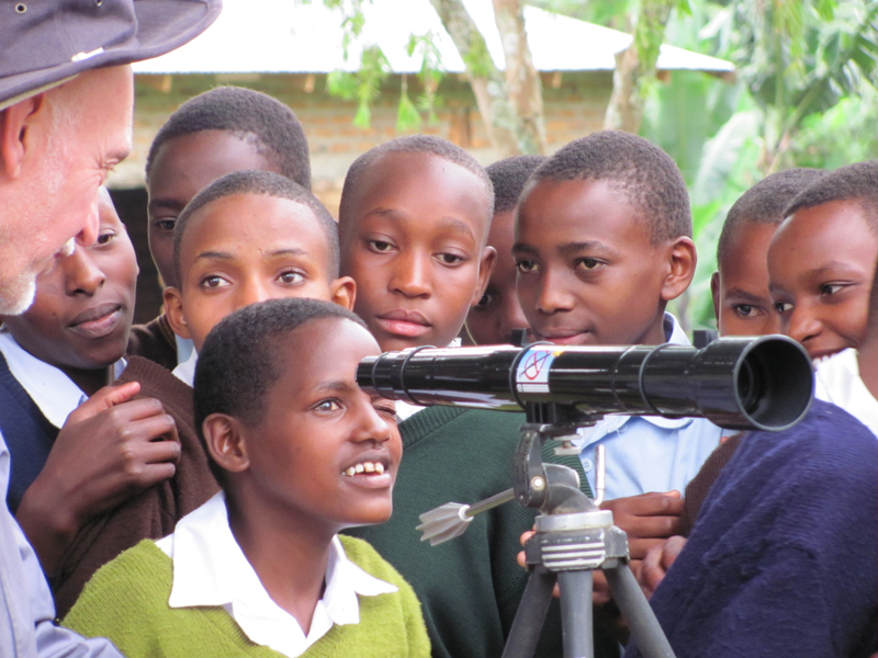 Children in Tanzania using a Galileoscope brought by Chuck Ruehle
