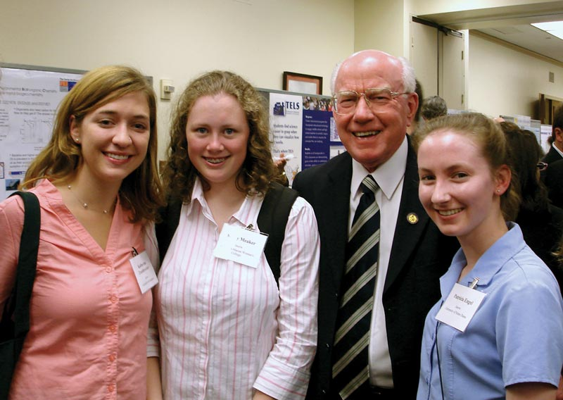 Patricia Engel (right) at the CNSF exhibition on Capitol Hill with, left to right, 2006 SPS interns Katherine Zaunbrecher and Kacey Meaker and Congressman Vernon Ehlers. Photo by Liz Dart Caron.