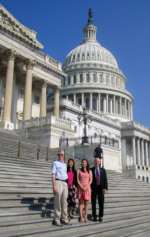 John Mather, Stankus, SPS intern Nikki Sanford, and Rep. Bill Foster (left-to-right) stand on the steps of the  United States Capitol. Photo courtesy of Katherine Stankus.