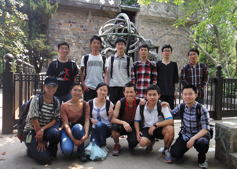 SPS members at Southeast University in Guangzhou, China, outside an observatory with an ancient Chinese astronomy instrument in the back. Photo courtesy of Zhi-Yong Zhou.