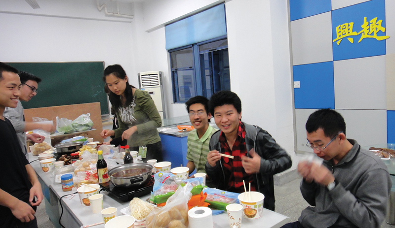"Southeast University's 2012 SPS ""Hot Pot"" party, with food similar to fondu. Photo courtesy of   Zhi-Yong Zhou."