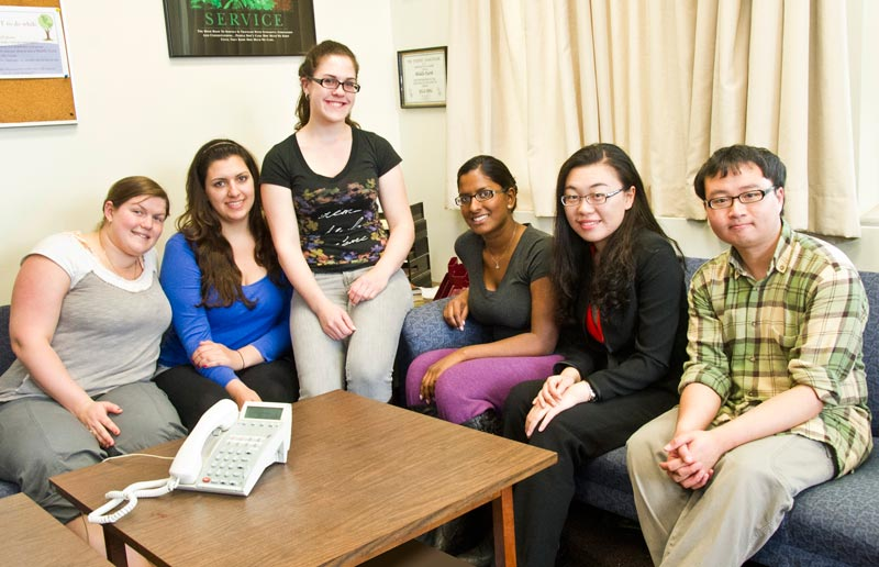 Support groups. Many colleges and universities have student groups that provide support for their peers. Shown here are members of the University at Albany's Middle Earth Peer Assistance Program who staff a hotline for students. Photo courtesy of Dolores Cimini.