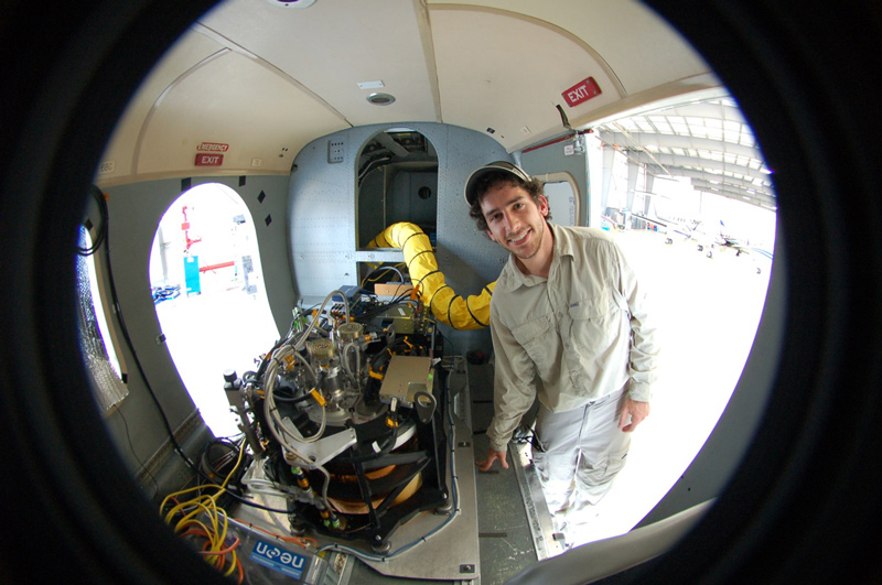 David Kelbe In the fuselage of NEON's (National Ecological Observatory Network) airborne imaging spectrometer. A spectrometer and waveform lidar (shown) are mounted to look out of a hole in the bottom of the aircraft. Photo courtesy of David Kelbe.