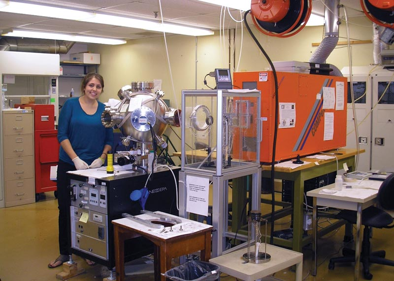 The author poses for a snapshot in her lab at  Towson University.