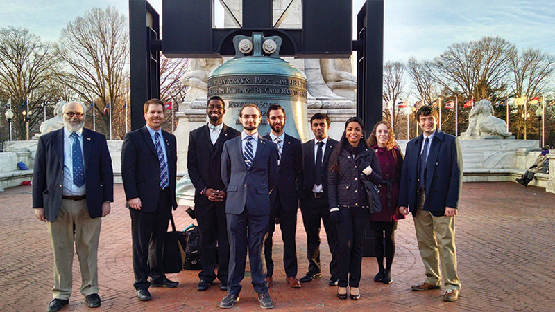 Amandeep Gill (third from right) poses with the SPS delegation on Capitol Hill. Photo by Courtney Lemon.
