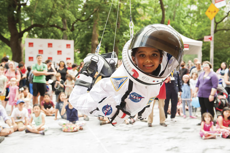 "Children get the unique opportunity to play astronaut for the day at ""Street Science."" Photo courtesy of the World Science Festival."