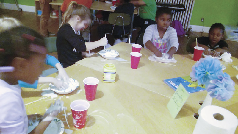 A Science Friday group making Oobleck. Photo courtesy of  Towson State University.