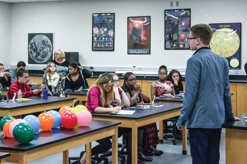 Robertson speaking to a room of students at an on-campus STEM night. Photo by Dominic Critchlow.