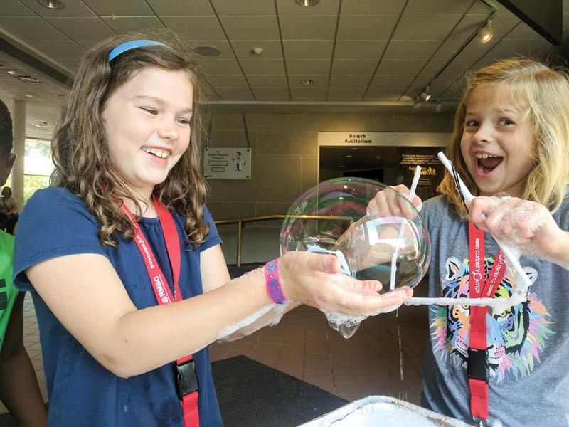 Who doesn't love bubbles? Campers made giant bubbles and were then able to explain why they observed them to be rainbow colored using principles of interference. Photo by Samantha Tetef.