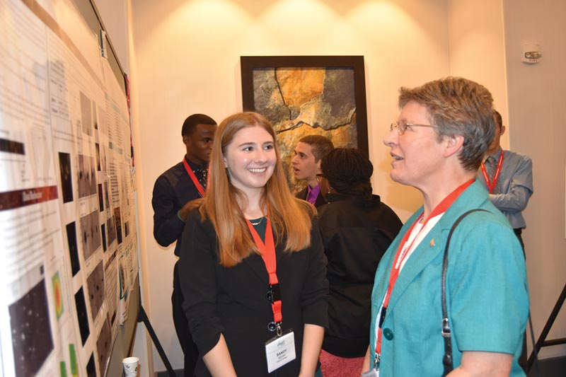 Sandy Spicer from Siena College takes questions from Dame Jocelyn Bell-Burnell at the poster sessions.