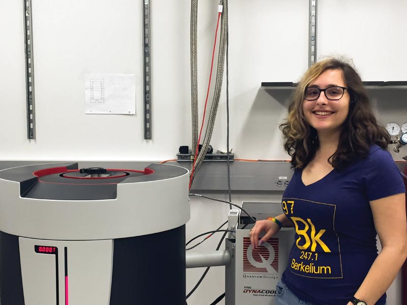Mayia Vranas in front of her lab's physical property measurement system. Photo courtesy of Mayia Vranas.