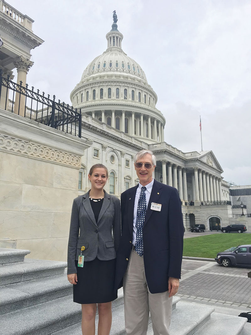 Eleanor stands with Dr. John Mather in front of the Capitol. Dr. Mather sponsors the AIP Mather Internship. Photo by Riley Troyer.