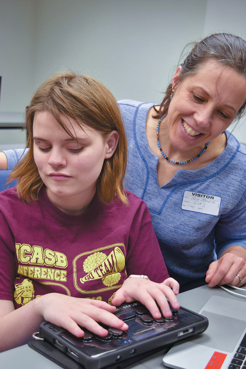 Elena Charles, an IDATA participant from the Wisconsin School for the Blind, helps Kate Meredith understand how astronomy software interacts with her new BrailleSense notetaker. Photo courtesy of Kate Meredith, GLAS Education.