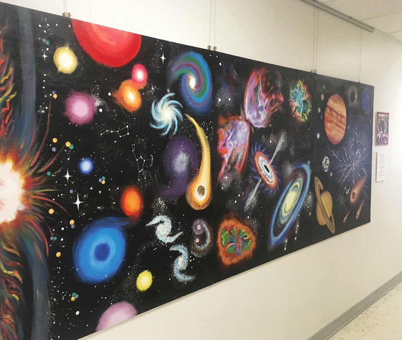 Cosmic Triptych on display in the University of Utah James Fletcher Building. Photo courtesy of Teddy Anderson.