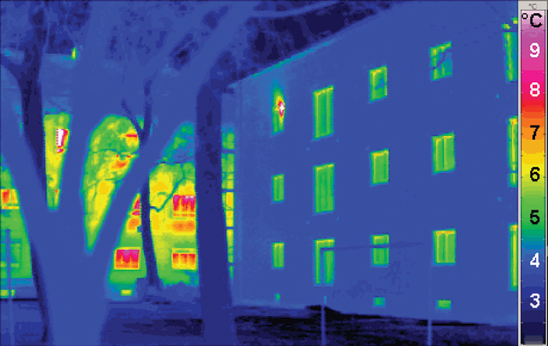 This thermal image contrasts the heat loss of an energy-efficient building (foreground) with a traditional building. Photo credit - Passive House Institute, PHI.