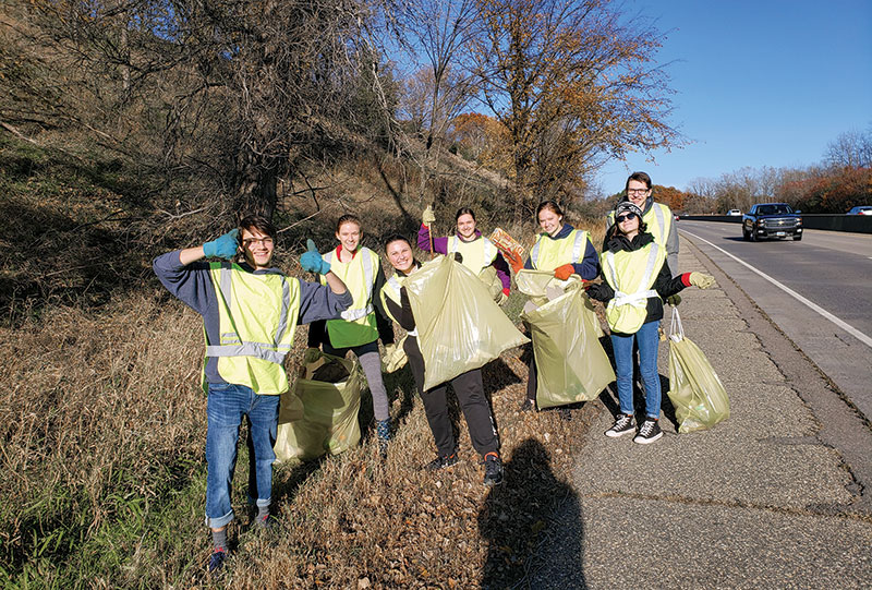 SPS members enjoy some sunshine while cleaning up along Highway 169.