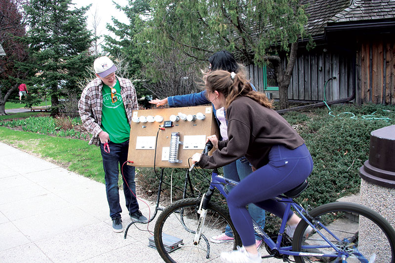 SPS members demonstrate the energy generated by a bicycle as part of the Discover the Outdoors event.