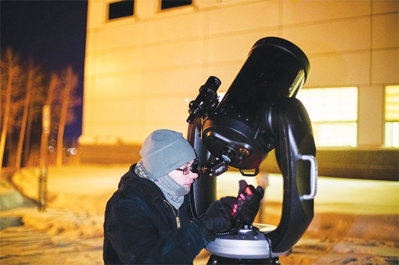 UAF SPS treasurer Austin Cohen aligns a telescope on the Pleiades star cluster at Astropalooza 2 in February 2019. Photo courtesy of Tanya Clayton.