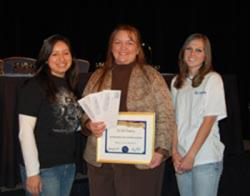 Meagan Saldua (left) and Kristin Peterson (right) pose with their SPS Advisor Dr. Toni Sauncy (center), after she was formally awarded the 2007 SPS Outstanding Chapter Advisor Award at the 2008 AAPT Winter Meeting awards ceremony.