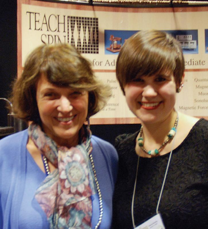 Amelia Plunk (right) poses with Barbara Wolff-Reichert in front of TeachSpin's booth at the vendor fair. Photo by Jonathan Reichert.