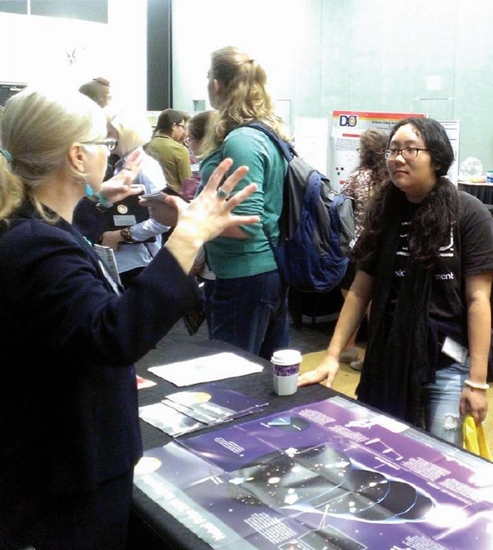 Beth Cunningham, president of AAPT, chats with a student during the meeting's industry fair. Photo by Lily Udumukwu.