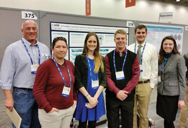 (From left to right) Dr. Rhett Herman, Melissa Brett, Jordan Eagle, Corey Roadcap, Cameron Baumgardner, and Sarah Montgomery pose for a photo in front of their poster presentation. Photo courtesy of Jordan Eagle.