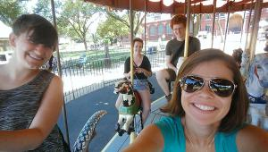 Kirsten, Kelby, Mark, and I embracing our inner childhood on the National Mall carousel.