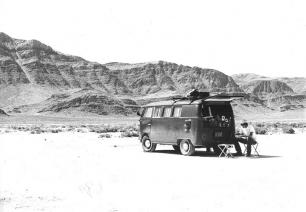 The author is shown sitting behind a 1964 VW Volkswagen bus in Sevier Lake (a salt flat) in western Utah, during a summer in his graduate school years. Out here peace of mind could be found. Why he did not do this more often back then he does not understand now. Photo by Douglas Strickland.