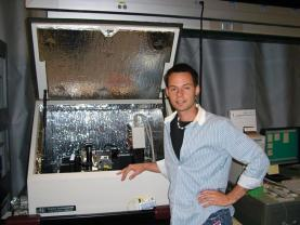 Anderson stands in front of a scanning probe microscope he frequently used during his 2005 SPS internship at NIST. Photos courtesy of Bridger Anderson.