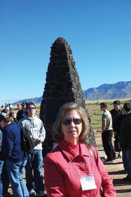 Mary beth monroe is pictured above at Trinity Site in New Mexico during the 2004 Quadrennial Congress of Sigma Pi Sigma. Photo by Tracy Nolis-Schwab.