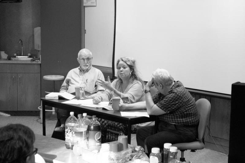 Megan Hickerson speaks about heresy, flanked by David Evans (left) and Jules Mollere (right). Photo by Dillan McNiel.