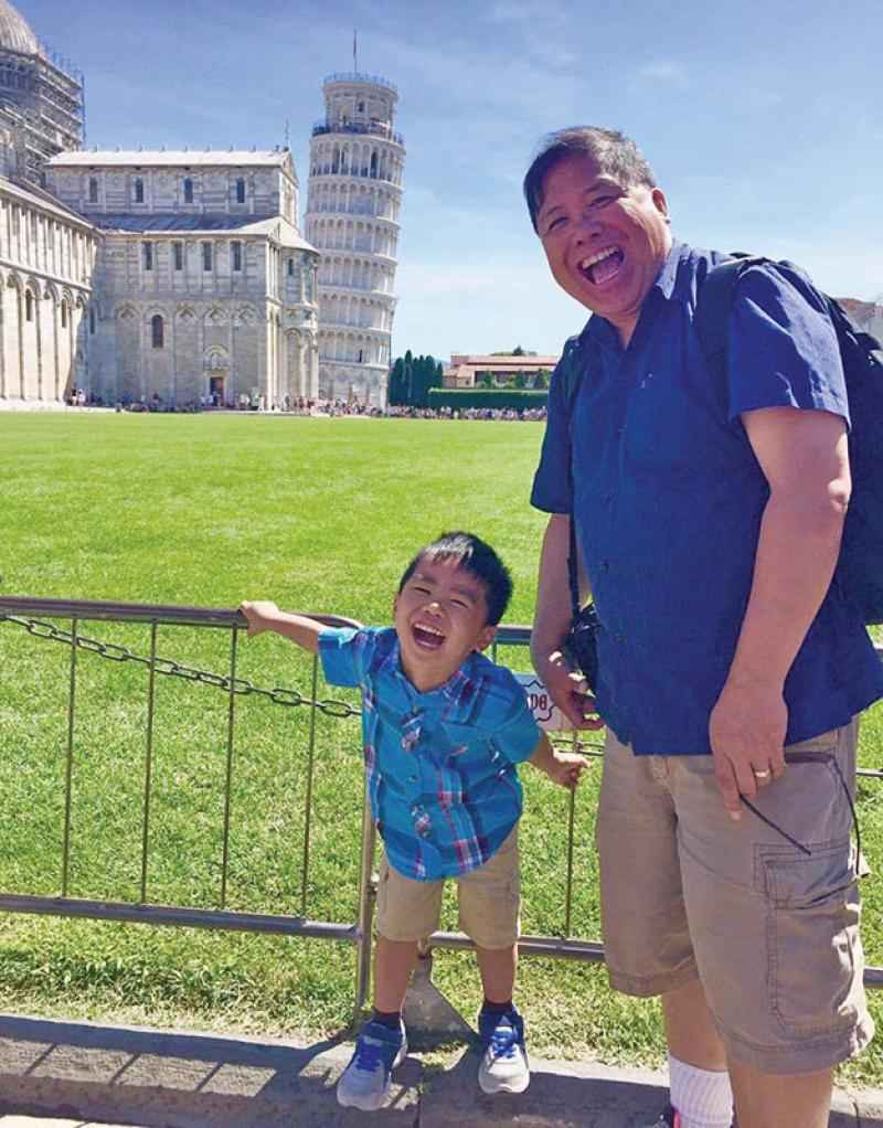 Ramos's love of physics extends beyond working hours. He is an amateur astrophotographer, a bargain hunter for research parts, and an enthusiastic traveler who finds physics everywhere. Here, he and his son enjoy a visit to the Leaning Tower of Pisa. Photo courtesy of Roberto Ramos.