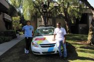 Left to right, SPS alumni Ben Perez and Sandeep Giri pose with one of Google's street-view cars