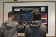 Colorado Mesa Universiy student Scott Jackson (left) presents his research poster.