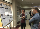 SPS member Eric Peterson discussing his research in condensed matter physics