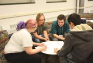 Students from UIUC and Middle Tennessee State University participate in the Fermi Challenge Problems activity. They were given outrageous scenarios to estimate quantities for and competed to have the highest score by guessing the correct order of magnitude.