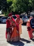 Aaron and Malwinder greeting Malwinder's parents before the wedding