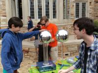 "Rhodes College SPS members with the Van de Graaf generator at the annual ""Rites to Play"" carnival."